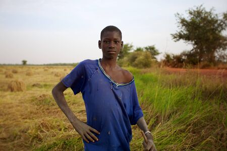 MALI, MOPTI, DECEMBER 31: Portrait of a unidentified farmer in the countryside close to Mopti working in the field in Mali, 2010