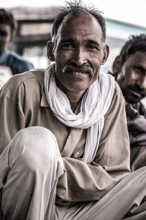 financed: INDIA, AGRA, JULY 18:  Portrait of of an unidentified man sitting and participating to a debate about the creation of a hospital in the countryside near Agra and financed by Oxfam. One of the leader in the Fair Trade industry in Europe, July 18, 2010, Ind