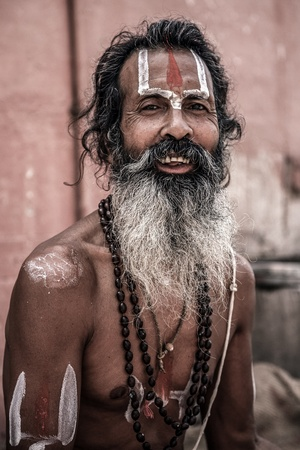 INDIA, VARANASI, JUNE 1: Portrait of an Holy Sadhu man with traditional painted face, praying near by the Gange in Varanasi, India. In Hinduism, sadhu is a common term for a mystic, an ascetic, practitioner of yoga and wandering monks, June 1, 2009, India Stock Photo - 20527347