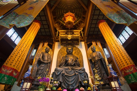transcendent: View of Three buddhas in a temple in Shanghai, China