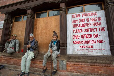 NEPAL, BHAKTAPUR, APRIL 24  Three unidentified elderly men sitting in front of a social welfare center, Bridhashram, Pashputi in Kathmandu Nepal , 22 April 2013