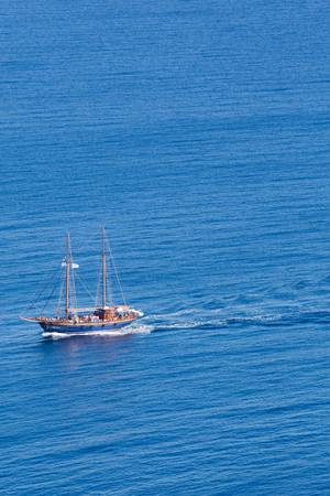 Little pleasure boat , filled with people on the calm aegean sea, greece 2013.