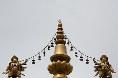 Religious gold symbol on top of a temple in Lhasa, China 2013 photo