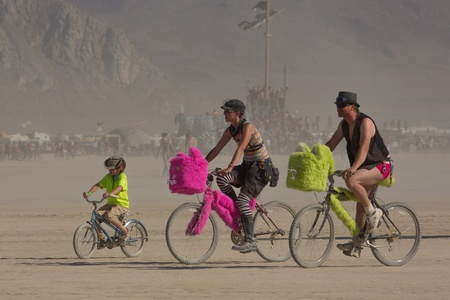 NEVADA, BLACK ROCK CITY, AUGUST 31: Unidentified family riding bicycles during the Burning Man Festival 2012. Having a bicycle at Burning Man is crucial, if not essential, to your overall enjoyment and experience within Black Rock City. August 31, 2012, U Editorial
