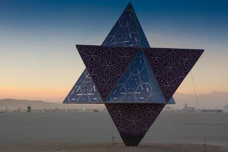 NEVADA, BLACK ROCK CITY, AUGUST 28: A Beautiful monumental artwork, pyramid-shaped at the Burning Man Festival 2012, Black Rock Desert, 2012