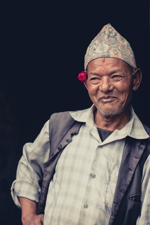 street wise: NEPAL, BHAKTAPUR, APRIL 24  unidentified Traditional clothed elderly man in the street , Nepal, 2013