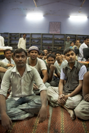 marginalized: AGRA,  INDIA, JULI 19: Group of workers wokring for fair trade Tara Organization in Agra, India and waiting to receive their annual medical card subscription, one of the basic rules within the fair trade industry. India 2010. Editorial