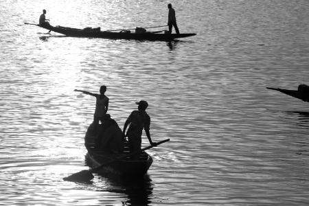 boatman: Romantic sunset atmosphere at river Niger in Mopti - Mali.