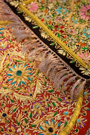 Symmetric design on an oriental rug made by Fairtrade producer in India. photo
