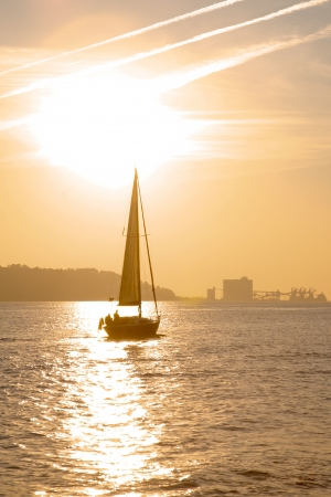 tagus: Sunset over Tagus river with sail boat, Portugal Stock Photo