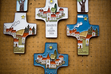 Composition of Christian religious crosses hanging on a canvas wall Lourdes, 2013. photo