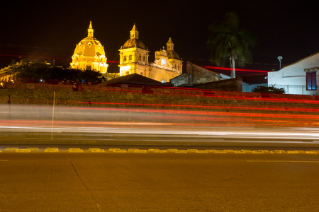 Streets of Cartagena at night with the Iglesia Church of Santo Domingo and speed lights, Cartagena, Colombia 2014. photo