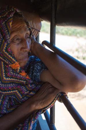 caribbeans: EL CABO DE LA VELA, COLOMBIA, JANUARY15  Unidentified portrait of Wayuu Indian old woman sitting in a 4x4 in La Guajira, Colombia 2014