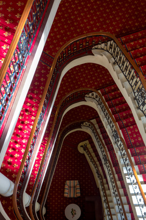 Massive red old classic staircase see from above in Bilbao hotel with view on comfortable lobby, Spain  Stock Photo - 27820259