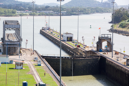 miraflores: Gates and basin of Miraflores Locks Panama Canal filling to raise a ship  Panama City, Panama 2014  Editorial