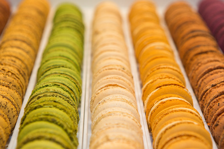 Traditional french colorful macarons in a rows in a box photo