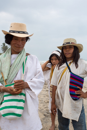caribbeans: PALOMINO, COLOMBIA, JANUARY 19: Group of unidentified Wayuu familly members posing in front of the camera on the Caribbean beach in Colombia 2014.