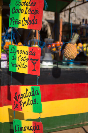 Rasta colors cocktails shop in the street of Taganga, Colombia 2014.