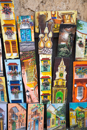 artisanry: CARTAGENA, COLOMBIA, JANUARY 8: Souvenirs shop in Cartagena, Colombia. Paintings and crafts typical of the Andean culture.