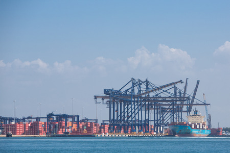 CARTAGENA, COLOMBIA, JANUARY 9: Cranes, containers and a ship at the Cartagena port on the Northern coast of Colombia, 2014