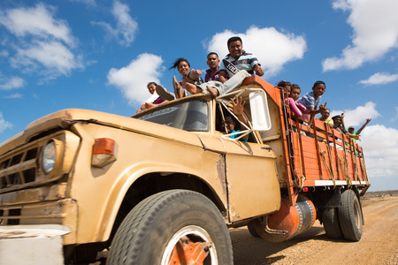 labouring: PUNTA GALLINAS, COLOMBIA, JANUARY 16: Unidentified Indian Colombian traveling on a truck and working in a salt mine in La Guajira, Colombia 2014. Editorial