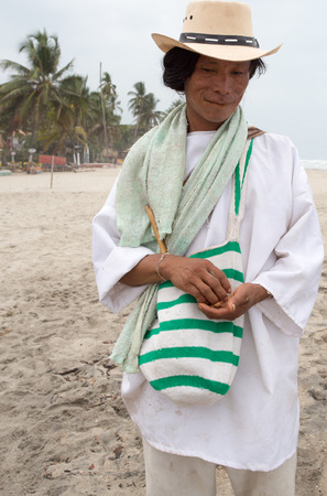 caribbeans: PALOMINO, COLOMBIA, JANUARY 19: Unidentified Wayuu man posing in front of the camera on the Caribbean beach in Colombia 2014.