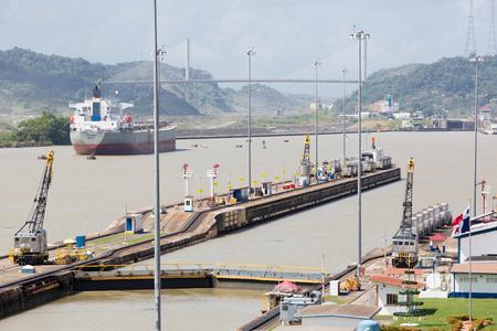 Gates and basin of Miraflores Locks Panama Canal filling to raise a ship. Panama City, Panama 2014.