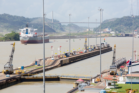 miraflores: Gates and basin of Miraflores Locks Panama Canal filling to raise a ship. Panama City, Panama 2014.