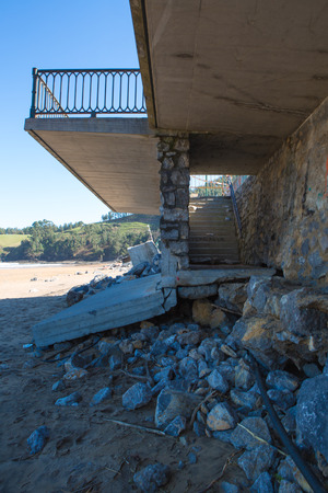 LEKETIO, SPAIN, MARCH 8: Damaged architecture at the entrance to the beach of Lekeitio, in the Basque Country, Spain in 2014 after Christine Storm. Editorial