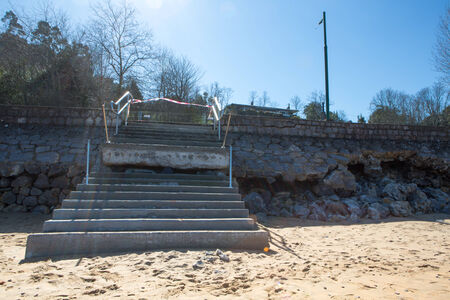 LEKETIO, SPAIN, MARCH 8: Damaged architecture at the entrance to the beach of Lekeitio, in the Basque Country, Spain in 2014 after Christine Storm.