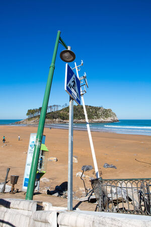 christine: LEKETIO, SPAIN, MARCH 8: Damaged architecture at the entrance to the beach of Lekeitio, in the Basque Country, Spain in 2014 after Christine Storm. Editorial