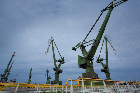 Industrial view massive cranes in the Shipyards in Gdansk, Poland. photo