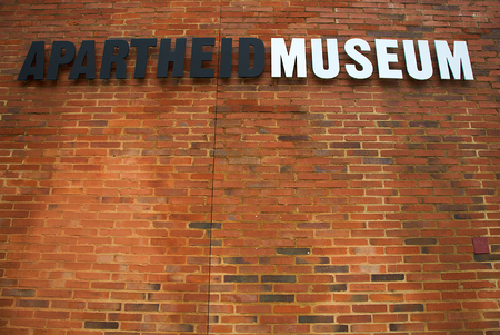 JOHANNESBURG, JANUARY 20: Apartheid Museum sign stands at the entrance to the museum on january 20, 2010 in Johannesburg. The pre-eminent museum in the world dealing with 20th century South Africa. Editorial