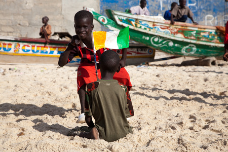 SAINT LOUIS, SENEGAL, DECEMBER 17: Unidentified group of Kids playing on the beach and smiling, Senegal, December 17, 2013