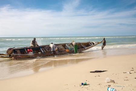 SAINT-LOUIS, SENEGAL, DECEMBER 4: Unidentified Fisher men in action on the beach of Saint -Louis in Senegal. 2010