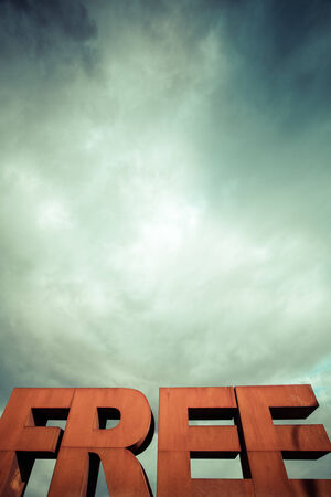 dramatic: Isolated single word FREE from volumetric letters with a dramatic sky in the background