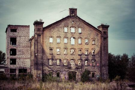 devastation: Ruined and abandoned industrial building with vintage street light in Gdansk Shipyard area