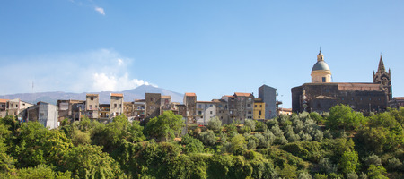 Houses in the city of Centuripe in Sicily, on background the volcano Etna partly in activity. Italy 2011. photo