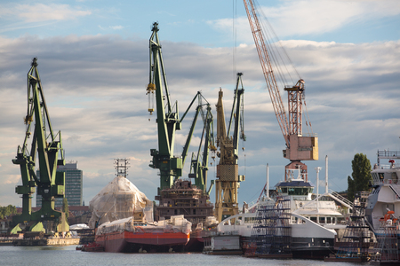 shiprepair: Gdansk, north of Poland on the Baltic Sea, Huge ships with cranes in Gdansk Shipyard. Poland 2013.