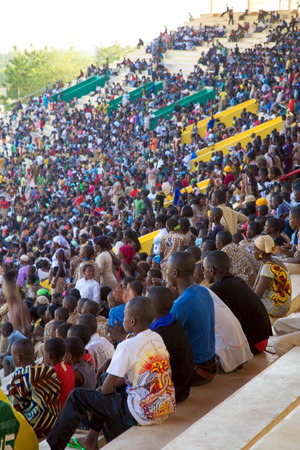 BAMAKO, MALI, JANUARY 11: Crowed Stadium in Bamako filled with many children looking at a soccer match during the inter scholarship competition, 2011