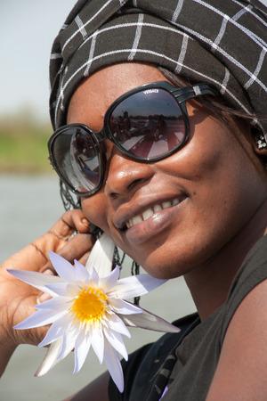 SAINT-LOUIS, SENEGAL, DECEMBER 12: Beautiful African typical woman smiling in Saint Louis, Senegal 2013.
