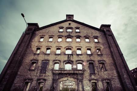 devastation: Abandonned industrial building in Gdansk Shipyard area Stock Photo