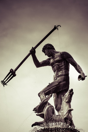 Detail of the statue of Poseidonon in Gdansk on a rainy and cloudy sky in the background, Poland photo