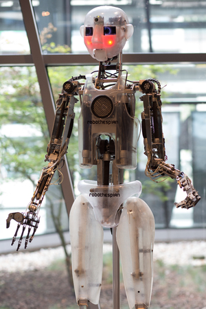WARSAW, POLAND, SEPTEMBER 15: Prototype of robot from the company Robothespian in Warsaw 2013. RoboThespian RT3 is a human-sized robot that was created to educate, communicate, interact and entertain humans