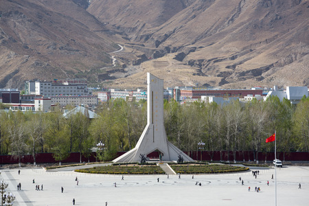 Monument to the Peaceful Liberation of Tibet. The 37-metre-high concrete monument is shaped as an abstract Mount Everest and its name is engraved with the calligraphy of former president Jiang Zemin