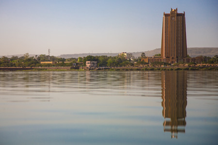 bamako: Modern architecture in front of the Niger River in Bamako with a clear still water and the reflection of the building