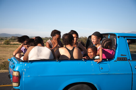 CAPE TOWN, SOUTH AFRICA, DECEMBER 14: unidentified group of South African people travelling in the back of a pickup. South Africa 2009