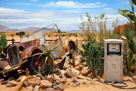 Old and rusty car wreck at the last gaz station before the namibian desert.