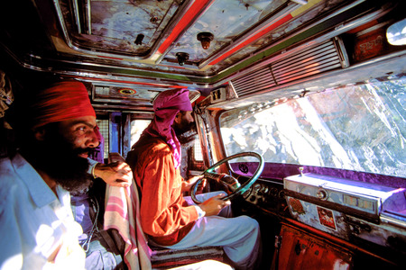 LEH, INDIA, APRIL 26: Indian Sikh drivers driving a colorful local truck in India in 2006.