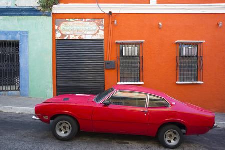 latina america: CIUDAD BOLIVAR, VENEZUELA, APRIL 9: Old American car parked in the old colonial city of Ciudad Bolivar. Venezuela. April 9, 2015. Editorial